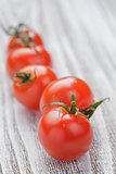 cherry tomatoes on white painted wood table