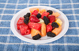 White Plate of Fresh Cut Fruit and Berries
