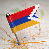 Nagorno-Karabakh Small Flag on a Map Background.