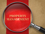 Property Management. Magnifying Glass on Old Paper.