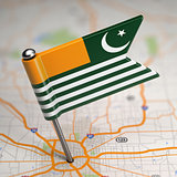 Azad Kashmir Small Flag on a Map Background.