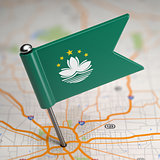 Macau Small Flag on a Map Background.