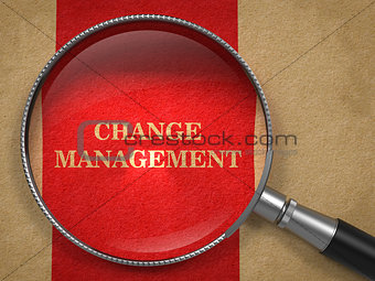 Change Management. Magnifying Glass on Old Paper.