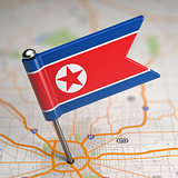 North Korea Small Flag on a Map Background.