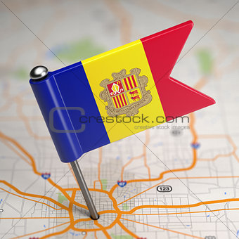 Andorra Small Flag on a Map Background.