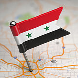 Syria Small Flag on a Map Background.