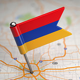 Armenia Small Flag on a Map Background.
