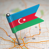 Azerbaijan Small Flag on a Map Background.