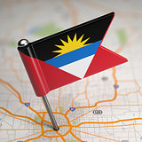 Antigua and Barbuda Small Flag on a Map Background.