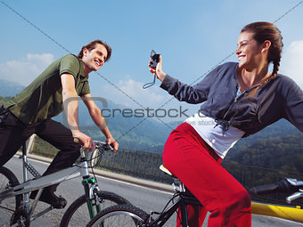 couple on bicycles in the park