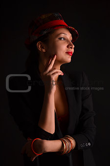 a charming young girl in a red hat