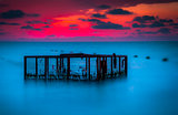 Seascape and Empty Cage at Colorful Sunset