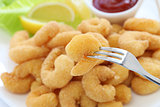 homemade popcorn shrimp on fork