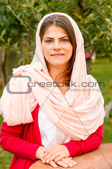 Beautiful middle eastern woman in pink scarf.