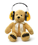 Teddy bear sitting with hear protectors