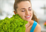 Portrait of young woman enjoying fresh salad