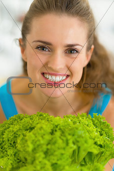 Portrait of happy young woman with fresh salad