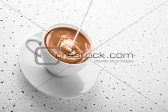 Cup of smooth coffee with poured milk