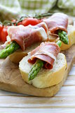 delicacy appetizer green asparagus and smoked ham