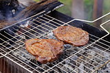 beef steak grilled on a barbecue outdoors