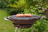 roasted sausages on a barbecue grill outdoors picnic