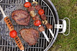Cooking on the barbecue grill assortment sausages steak and skewers