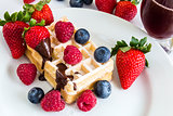 sweet fresh mixed fruits with tasty waffles and red juice