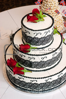 Three Tiered Rose Covered Wedding Cake