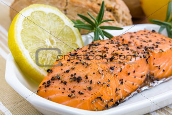 spicy smoked salmon with lemon and bread bun