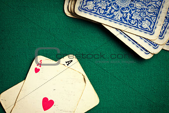 antique cards on green casino table