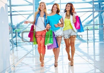 Three shoppers in the mall