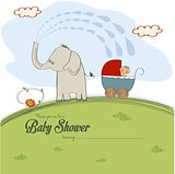 baby shower card with a boy in stroller sprayed by an elephant