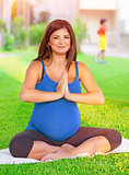 Pregnant female exercising in the park