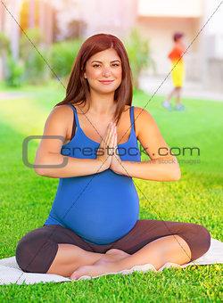 Pregnant female exercising in the park
