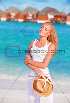 Pretty woman walking along beach