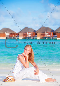 Pretty female on luxury beach resort