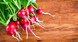 bunch of radish on wooden board
