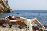 Beautiful woman sunbathing on the beach on vacations