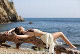 Beautiful woman sunbathing on the beach on vacations