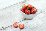 Strawberries on white wooden background