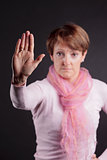 mature woman with a raised closed hand