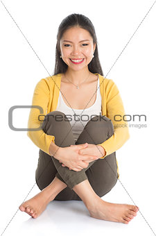 Asian woman full body seated