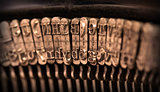 Close-up of an old retro typewriter with paper