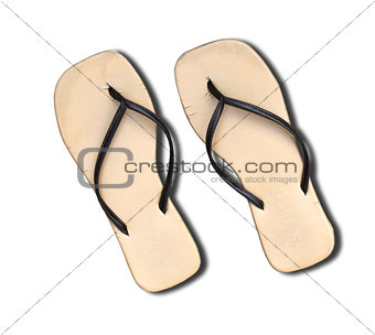 Pair of old flip flop sandals isolated on white.