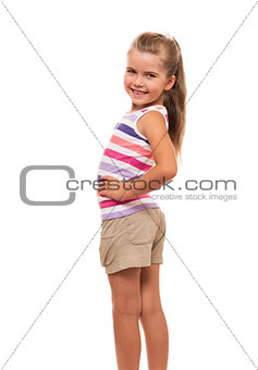 little girl turned aside standing on white background