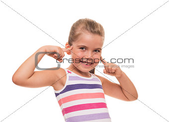 lttle girl putting her fingers to her head on white background