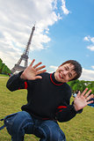 Smiling boy in front of the Eiffel Tower (La Tour Eiffel) in Par