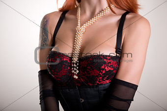 Busty redhead woman in vintage red bra