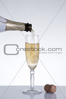 Champagne pouring into an elegant glass