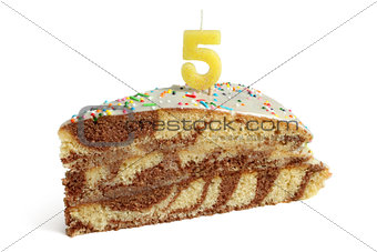 Slice of birthday cake with number five candle
